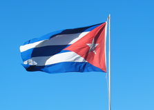 Cuban Flag. Waving in the breeze against a blue sky Stock Images