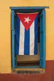 Cuban flag at window. Trinidad,Cuba Royalty Free Stock Photography