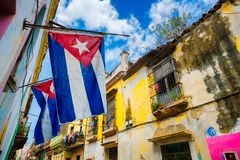 Cuban flags and decaying buildings in Old Havana. Cuban flags and colorful decaying buildings in Old Havana royalty free stock photo