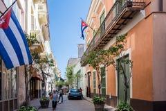 Cuban flags in street with colonial buildings, Habana Vieja, Havana, Cuba stock photo