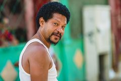 Cuban Man. As seen on the streets of Havana. Blurry colorful background stock photo