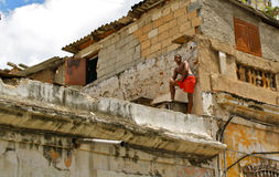Decay, Havana. Cuban man on the roof of a decayed house in Havana, Cuba Stock Photography