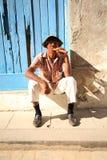 Cuban man with a fat Cuban cigar. In Havana Cuba Royalty Free Stock Image