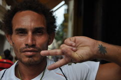 Cuban man havana cuba peace sign marajuana leaf Royalty Free Stock Images