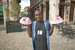 A Cuban man holding cakes in both hands, in historic old Havana, Cuba Royalty Free Stock Image