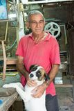 Cuban Man Petting his mutt dog Royalty Free Stock Photos