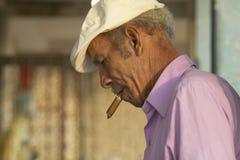 A Cuban man smoking a cigar in El Rincon, Cuba Stock Photos