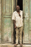 Cuban man standing in doorway Royalty Free Stock Photography