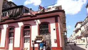 Moving sofa from the roof of the house in Havana Cuba stock video