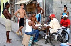 Cuban Men Playing Domino on the Street, Havana. Group of men playing improvised domino in sidewalk. Havana, Cuba Royalty Free Stock Photo