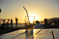 Cuban mojito at sunset on a beach bar. A delicious Cuban Mojito in a beach bar while the sun sets on a summer afternoon Royalty Free Stock Photo
