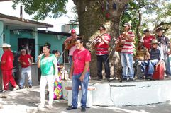 Cuban music band. Playing popular songs on a patio of small outdoor bar in Cuba Stock Photography