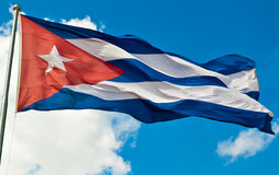 The Cuban National Flag. With a beautiful sky background Stock Photos