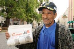 Cuban Grandma newspaper street seller in Havanna City stock photos