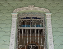 Cuban old colonial architecture: detail of elaborated window Royalty Free Stock Photo