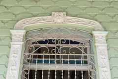Cuban old colonial architecture: detail of elaborated window Stock Photography