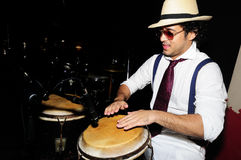 Cuban percussionist  on black Stock Image