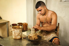 Cuban potter and his work Stock Images