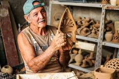 Cuban potter and his work Royalty Free Stock Images