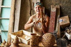 Cuban potter and his work Royalty Free Stock Photos
