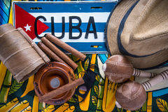 Cuban related items on vibrant background. From above, travel concept Royalty Free Stock Photos