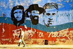 Cuban Revolution Leaders, Havana. Wall painting shoowing the faces of three cuban leaders (Che Guevara, Cienfuegos and ?) in Havana stock photo