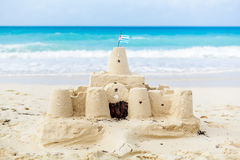 Cuban Sandcastle with the country Flag in Cuba. Cuban Sandcastle with the country Flag on one of the most Beautiful Beach of Cuba Stock Photo