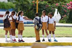 Cuban schoolchildren. Cuban children in uniform on the bus stop, going home after school. Varadero. Cuba Stock Image