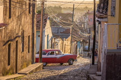 Cuban street with oldtimer in Trinidad. Cuba Royalty Free Stock Photos