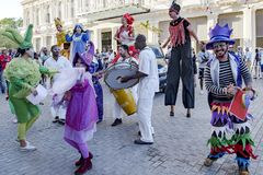 Cuban street performers dancing on stilts, Havana, Cuba royalty free stock photos