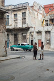Cuban street scene with people and classic car Royalty Free Stock Photo