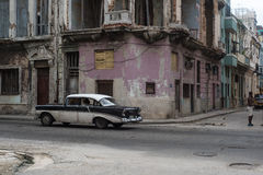 Cuban street scene with people and classic car Stock Images