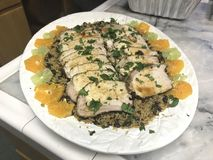 Cuban Grilled Whole Pork Loin with Rice & Beans. Cuban-style Mojo Grilled Whole Pork Loin with Rice & Beans with sliced oranges and limes on a large white royalty free stock photos