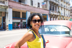 Cuban woman and an old red car in Havana, Cuba Stock Image