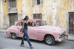 Cuban Woman Pink Taxi Car Royalty Free Stock Images