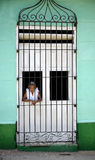 Cuban woman at the window. An aged cuban woman at the window in Trinidad, Cuba Royalty Free Stock Image