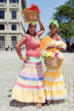 Cuban women wearing traditional dresses Stock Images