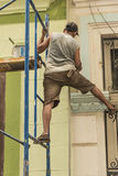 Cuban worker balancing on scaffold Havana Royalty Free Stock Photos