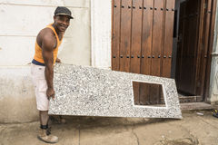 Cuban worker delivering kitchen zink of molded concrete royalty free stock image