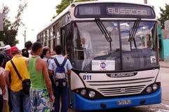 Cubans boarding local municipal bus. Cubans boarding local municipal overclouded bus in Cuba Royalty Free Stock Photography