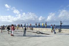 Cubans fishermens. Are fishing in the Malecon quay on 28 November 2015 in Havana, Cuba Royalty Free Stock Photos