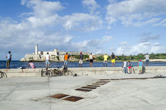 Cubans fishermens. Are fishing in the Malecon quay on 28 November 2015 in Havana, Cuba Royalty Free Stock Image