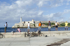 Cubans fishermens. Are fishing in the Malecon quay on 28 November 2015 in Havana, Cuba Stock Photography