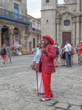 Cubans make money. Cuba, Havana, December 5, 2015, the historic center of the city, a Cuban dressed in bright costume is photographed with a tourist, to make Stock Photos