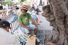 Cubans Playing Chess in a Plaza. Cuban people playing chess on a plaza in Old Havana Stock Photography