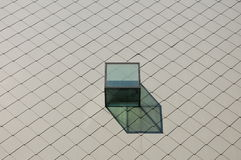 Cube. In the middle of a wall Royalty Free Stock Photography