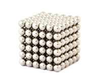 Cube assembled from magnetic balls. Cube assembled from little metallic magnetic balls isolated on white royalty free illustration