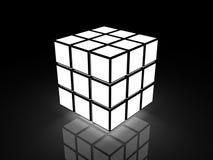 Cube avec des images légères sur un fond noir Photographie stock libre de droits