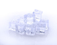 Cube of blue ice  on a white background. Cube of blue ice  on a white Stock Images