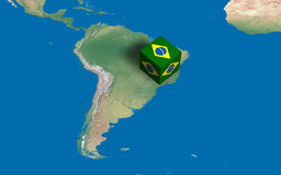 Cube with Brazilian flag over the map. 3d design rendered of a cube with Brazil flag over the map Royalty Free Stock Images